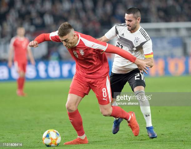 Soccer International match Germany Serbia in the Volkswagen Arena Germany's Ilkay Gündogan and Milan Pavkov from Serbia fight for the ball IMPORTANT...
