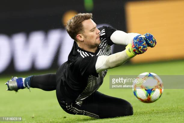 Soccer International match Germany Serbia in the Volkswagen Arena Germany goalkeeper Manuel Neuer fends off a ball when warming up IMPORTANT NOTE In...