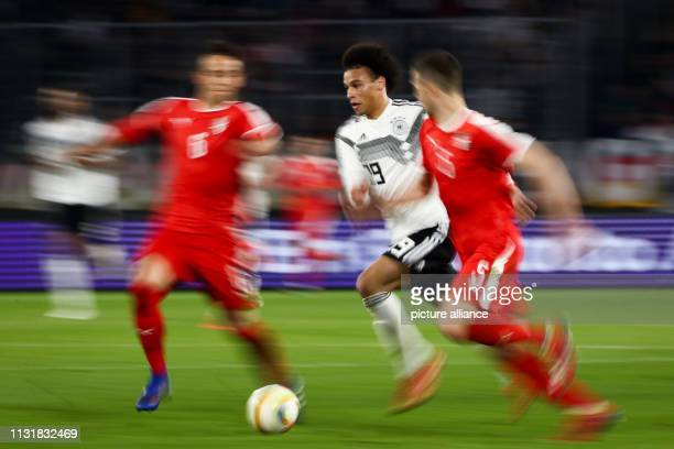 Soccer International match Germany Serbia in the Volkswagen Arena Germany's Leroy Sane prevails IMPORTANT NOTE In accordance with the requirements of...