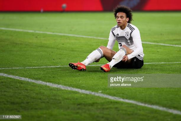 Soccer International match Germany Serbia in the Volkswagen Arena Germany's Leroy Sane is sitting on the lawn IMPORTANT NOTE In accordance with the...
