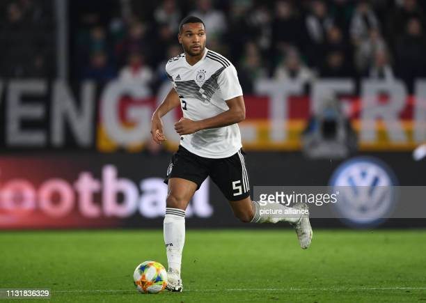 Soccer International match Germany Serbia in the Volkswagen Arena Germany's Jonathan Tah plays the ball IMPORTANT NOTE In accordance with the...