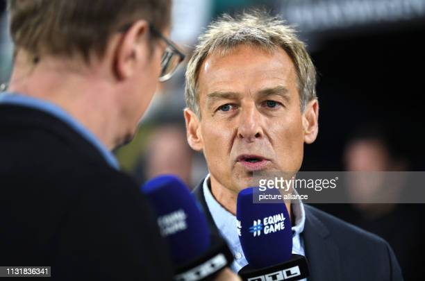 Soccer International match Germany Serbia in the Volkswagen Arena Jürgen Klinsmann former soccer player and team boss of the German national soccer...