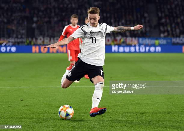 Soccer International match Germany Serbia in the Volkswagen Arena Germany's Marco Reus plays the ball IMPORTANT NOTE In accordance with the...