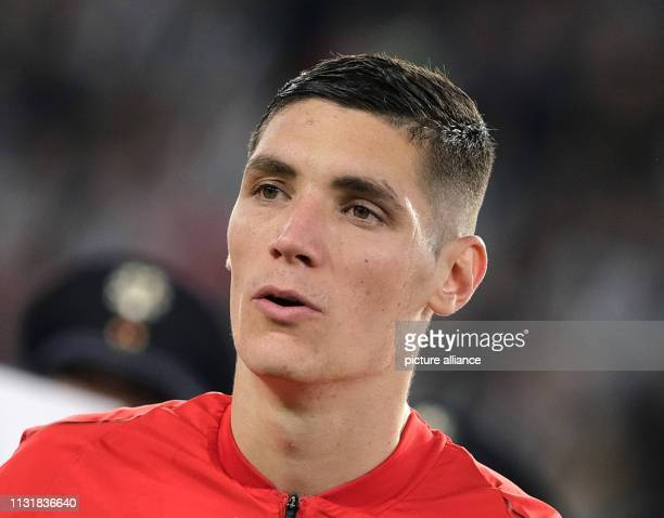 Soccer International match Germany Serbia in the Volkswagen Arena Serbia's Nikola Milenkovic IMPORTANT NOTE In accordance with the requirements of...