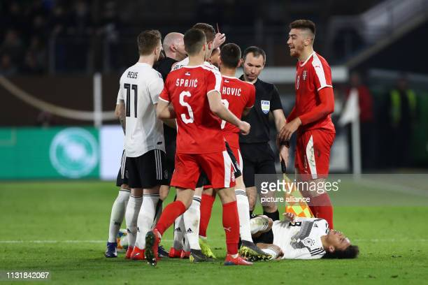 Soccer International match Germany Serbia in the Volkswagen Arena Leroy Sane from Germany lies on the ground after being fouled by Milan Pavkov...