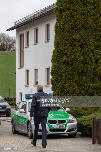 A police car stands in front of a residential building Police found three bodies in the family home in Lower Bavaria All three are adults and related...