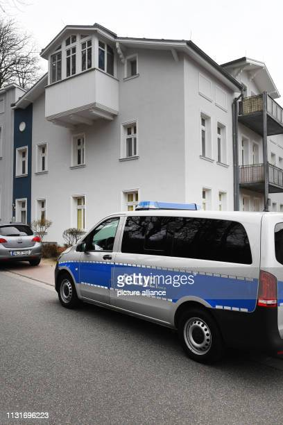 March 2019, Mecklenburg-Western Pomerania, Zinnowitz: A police vehicle is standing in front of a house in which a young woman has been found dead....