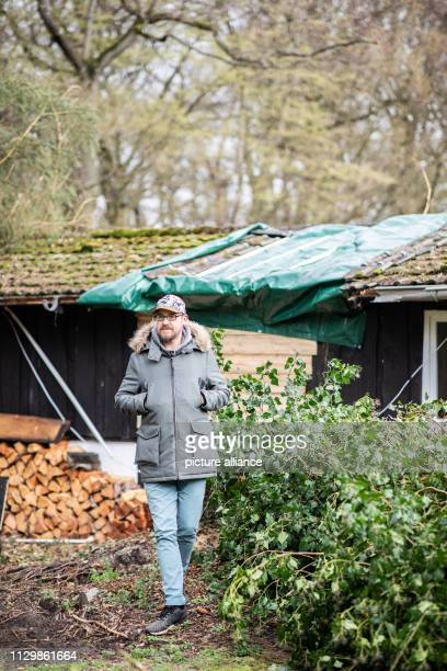 11 March 2019 North RhineWestphalia Mülheim an der Ruhr Andreas Kallweit stands in front of his garden house next to the tree that fell on his house...