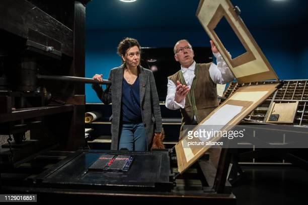 07 March 2019 RhinelandPalatinate Mainz Eva Menasse journalist and writer from Austria stands with Wolfgang Neumann museum printer at the replica of...