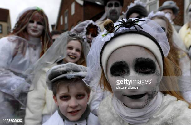 Carnivalists dressed up as zombies take part in the foolish hustle and bustle in Marne The Rose Monday procession has once again attracted thousands...