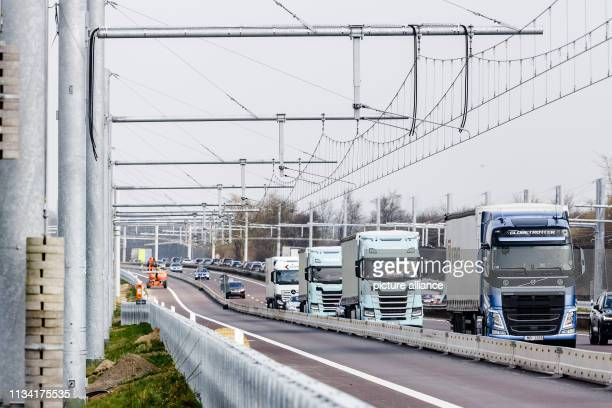 30 March 2019 SchleswigHolstein Reinfeld Trucks drive past newly installed overhead line systems on motorway 1 The expansion of the test sections for...