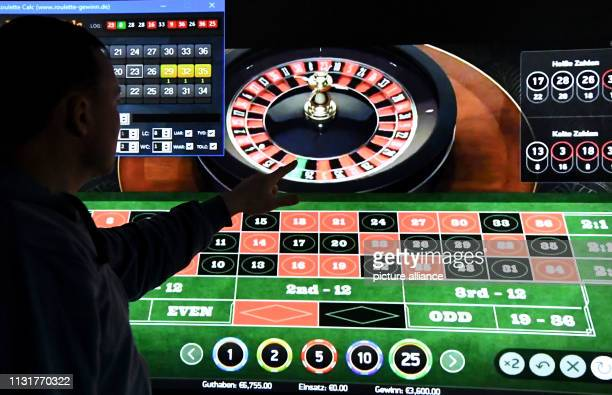 15 March 2019 ScxhleswigHolstein AukrugHomfeld ILLUSTRATION A man stands in front of a screen with a page for online roulette The topic of gambling...