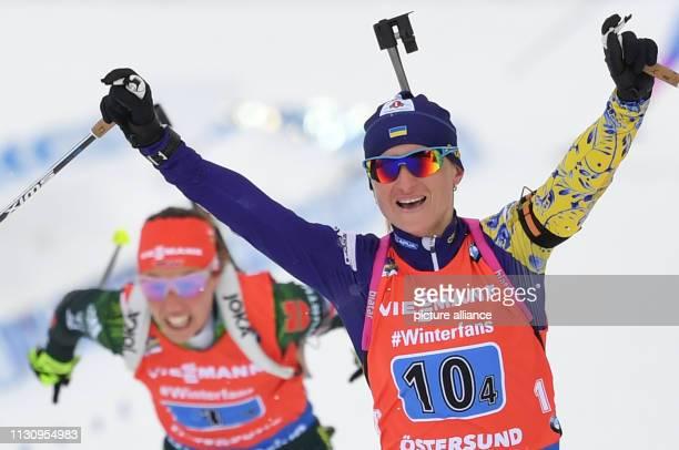 Biathlon World Championship Relay 4 x 6 km Women Valj Semerenko from Ukraine cheers on the finish line ahead of Laura Dahlmeier from Germany Photo...