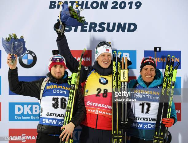Biathlon World Championship Sprint 10 km Men Second placed Alexander Loginov from Russia first placed Johannes Thingnes Bö from Norway and third...