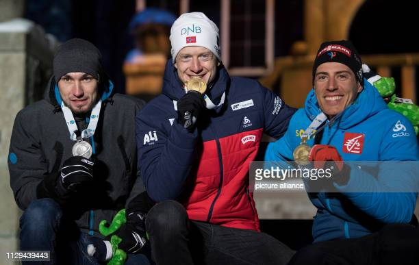 Biathlon World championship sprint 10 km men medal ceremony Alexander Loginow from Russia Johannes Thingnes Bö from Norway and Quentin Fillon Maillet...