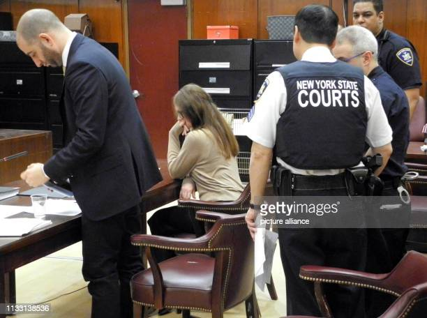 The German suspected impostor Anna Sorokin sits next to her defender Todd Spodek in the courtroom before the start of her trial With a combination of...