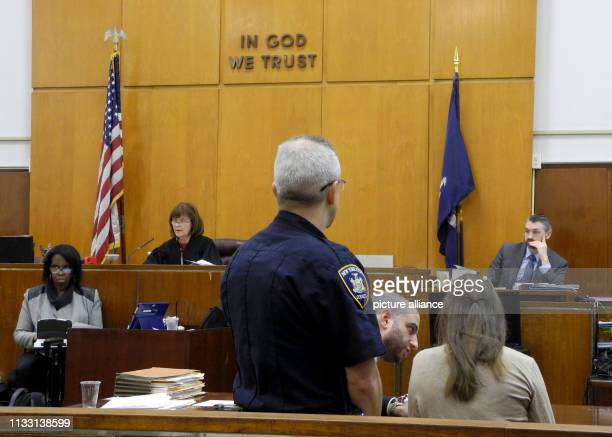 The German suspected impostor Anna Sorokin sits next to her defender Todd Spodek in the courtroom during her trial judge Diane Kiesel sits in the...