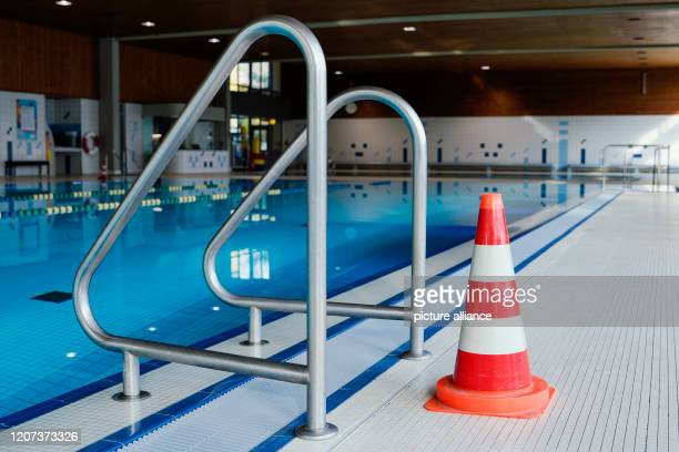 16 March 2020 BadenWuerttemberg Heidelberg A pylon stands in the indoor swimming pool Köpfel on a ladder of the swimming pool The swimming pool is...
