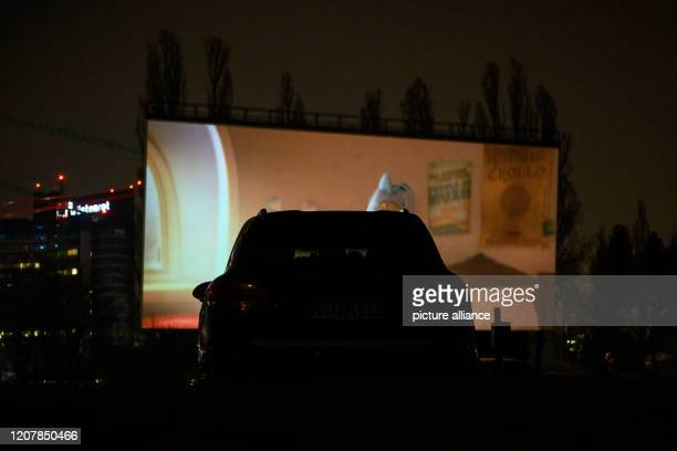 20 March 2020 BadenWuerttemberg Kornwestheim There's a car at the Drive In drivein at 752 In contrast to conventional cinemas the drivein cinema may...