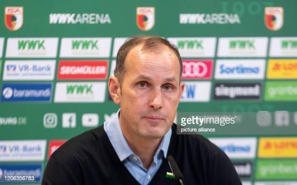 Heiko Herrlich is sitting at a press conference in the WWKArena Herrlich was introduced as the new head coach of the Bundesliga soccer team FC...