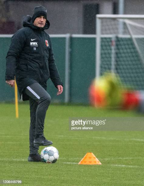 Heiko Herrlich plays with a ball on the training ground of FC Augsburg The 48yearold led his first training session at the Bundesliga club FC...