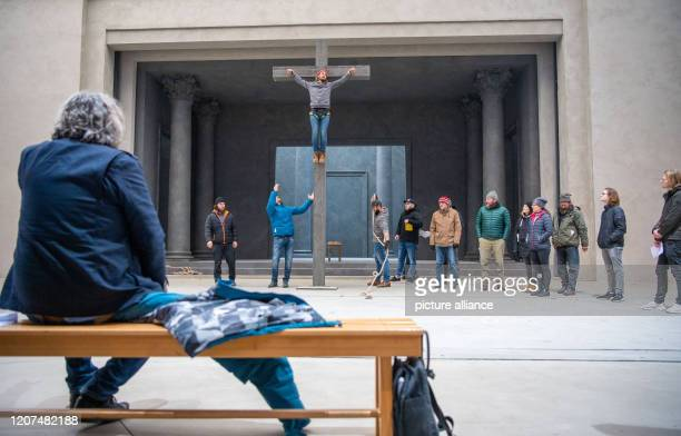 Christian Stückl director of the Oberammergau Passion Plays sits on stage during a rehearsal with Frederik Mayet who plays the role of Jesus Christ...