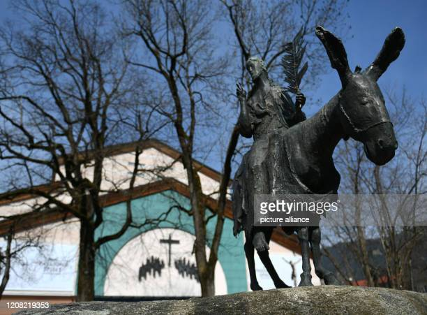Jesus as he rides on the donkey stands as a statue in front of the Passion Theatre After the cancellation of the Oberammergau Passion Plays the...