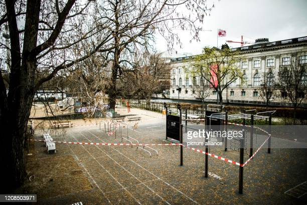 March 2020, Berlin: Barrier tape secures a sports facility in Monbijoupark against unauthorised access. To slow down the spread of the corona virus,...