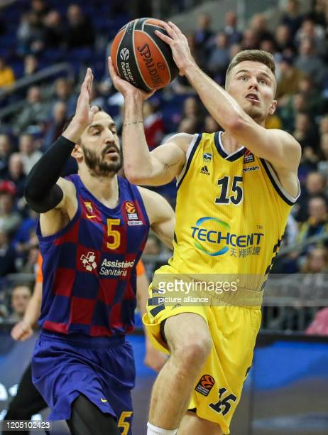 Basketball Euroleague Alba Berlin FC Barcelona main round 27th matchday Mercedes Benz Arena Albas Martin Hermannsson plays the ball before Pau Ribas...