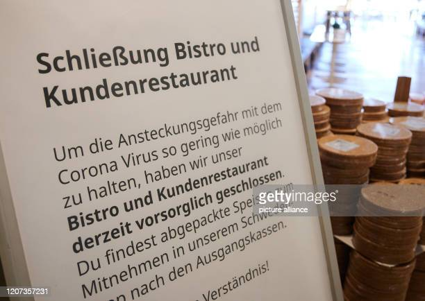 "March 2020, Berlin: ""Closing of bistro and canteen,"" it says on the sign in a department store. Because of the Corona epidemic, many cafes and..."