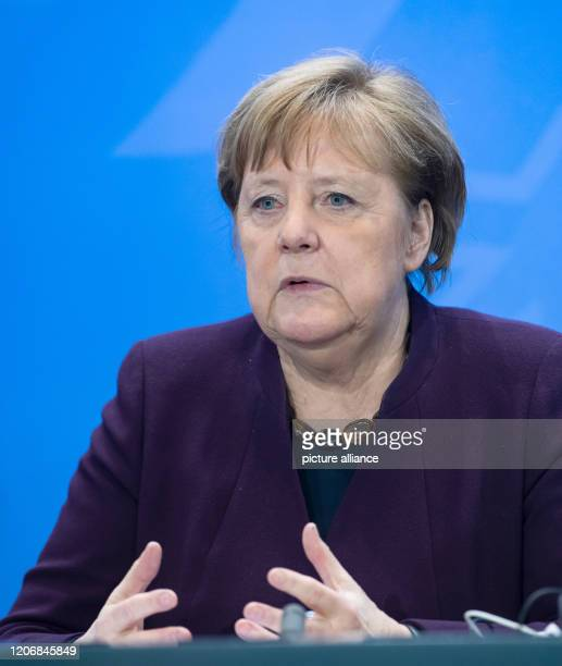 March 2020, Berlin: Federal Chancellor Angela Merkel spoke at a press conference after her meeting with other members of the Federal Government and...