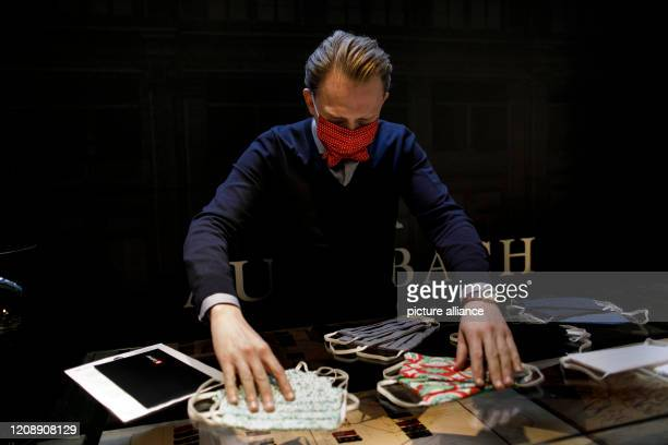 March 2020, Berlin: Jan Scheper-Stuke, managing director of the Berlin tie manufacturer Auerbach, sorts new mouth-nose masks from the production in...