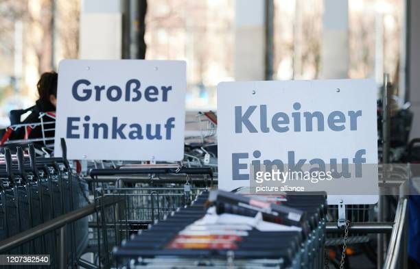Large Shopping and Small Shopping is written on the signs in front of shopping carts The trolleys for the big shopping are all in use Because of the...