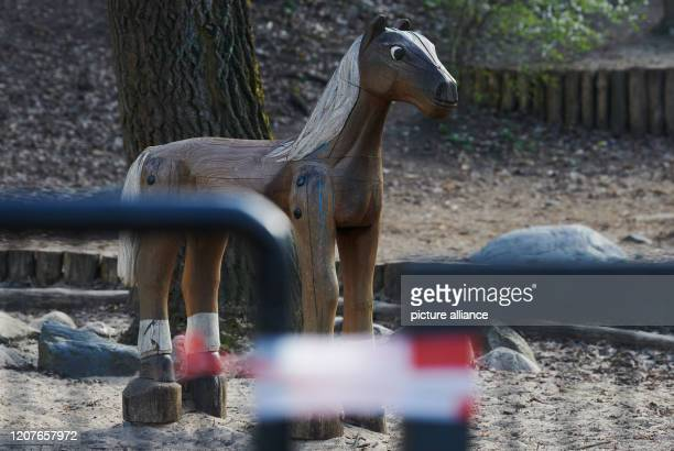 March 2020, Berlin: The entrance of a playground in Volkspark Friedrichshain is closed with a barrier tape. Many playgrounds in Berlin are not...
