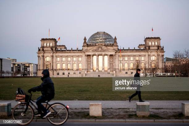 March 2020, Berlin: The Reichstag building, seat of the German Bundestag. Despite the corona crisis, the Bundestag wants to meet for a session on...