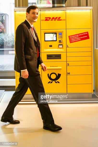 March 2020, Berlin: Tobias Meyer, Member of the Board of Management of Deutsche Post DHL Group responsible for Post & Parcel Germany, passes a parcel...