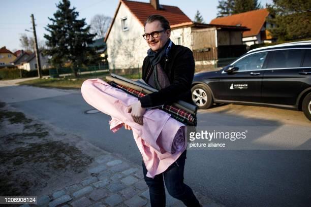 March 2020, Brandenburg, Strausberg: Jan Scheper-Stuke, managing director of the Berlin tie manufacturer Auerbach, wears fabrics to a seamstress for...