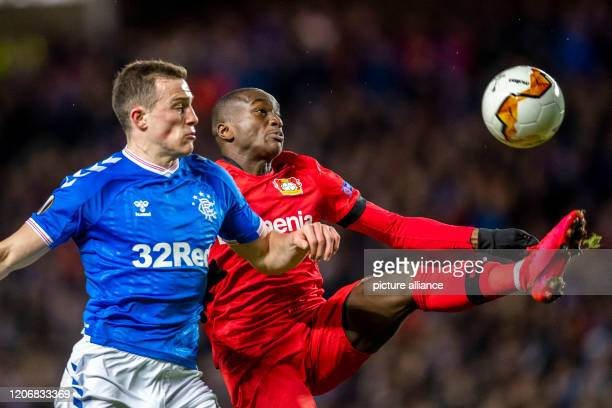 Football Europa League Glasgow Rangers Bayer Leverkusen knockout rounds last sixteen first legs at Ibrox Stadium Glasgow's George Edmundson and...