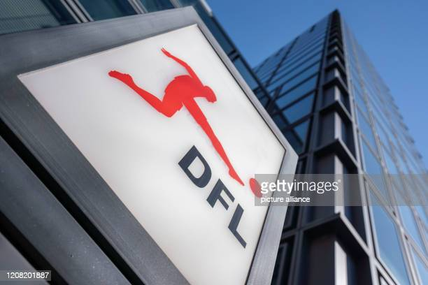The logo of the German Football League can be seen at the entrance to the headquarters Following the recommendation for an extended suspension of...