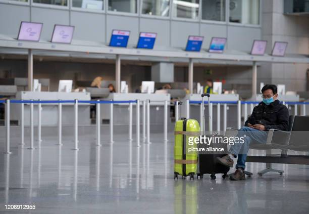This man protects himself with a face mask in the departure hall of the terminal As of Saturday there will be a ban on entry into the USA for...
