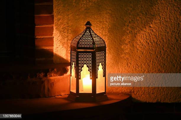 A light of hope stands in front of a front door in the Südstadt district Through Whatsapp the Lutheran church congregation of KasselSüdstadt had...