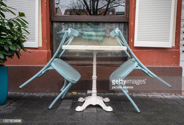 Two café chairs stand tilted to the table at Offenbach's market place Restaurants and pubs in Hesse must remain closed since 1200 noon on Saturday...