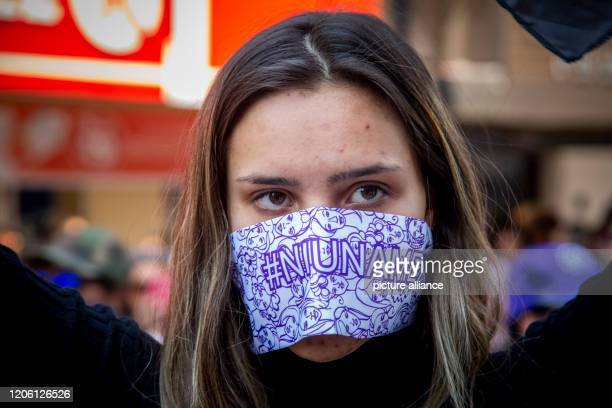 A woman is wearing a mask during a march on International Women's Day After several sensational murders of women tens of thousands of demonstrators...