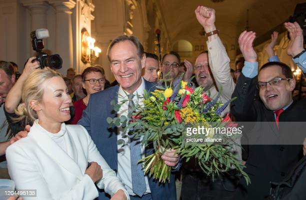 Burkhard Jung Lord Mayor of Leipzig and candidate of the SPD for the Lord Mayor's election cheers when entering the city hall together with his wife...