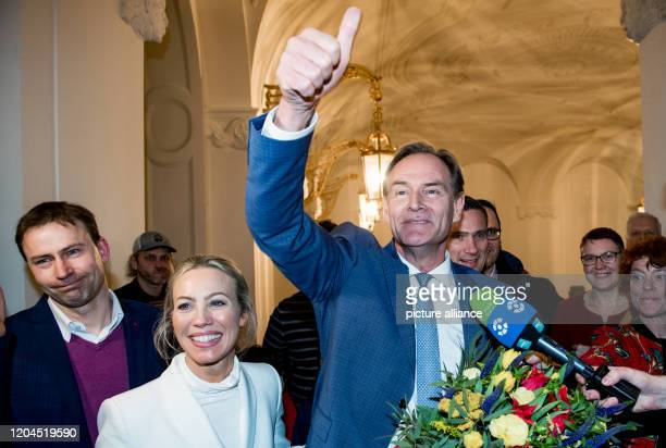 Burkhard Jung Lord Mayor of Leipzig and candidate of the SPD for the Lord Mayor's election cheers when entering the city hall next to his wife...