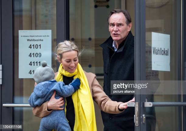 Burkhard Jung Lord Mayor of Leipzig leaves his polling station with his wife Ayleena and their child The citizens of Saxony's largest city will...