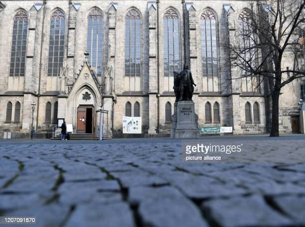 View into an empty Thomaskirchhof with the monument for Johann Sebastian Bach in Leipzig The effects of the coronavirus epidemic are also being felt...