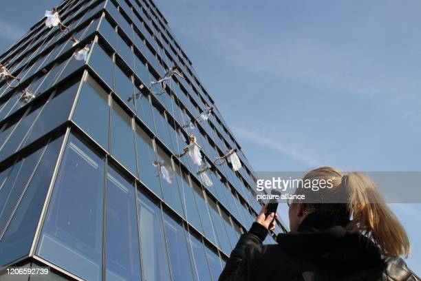 A woman photographs the performers on the house wall during the official opening ceremony of the triangular viewing platform Edge The platform is in...
