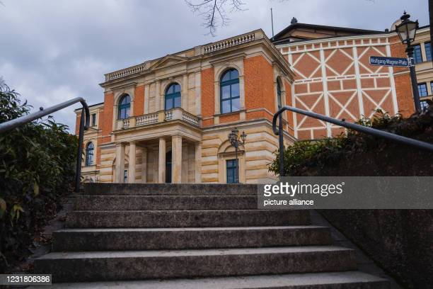 March 2021, Bavaria, Bayreuth: Clouds are gathering over the Festspielhaus in Bayreuth. Cultural institutions have had to remain closed for months...