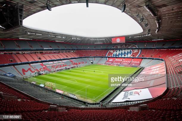 March 2021, Bavaria, Munich: Football: Bundesliga, Bayern Munich - VfB Stuttgart, Matchday 26 at Allianz Arena. The empty Allianz Arena can be seen...